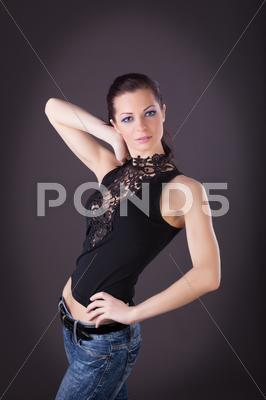 Stock photo of attractive woman in lacy dress and jeans