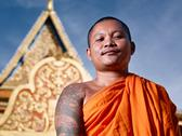 Stock Photo of portrati of buddhist monk near temple, cambodia, asia