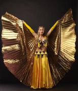 Beauty woman dance with gold wing Stock Photos