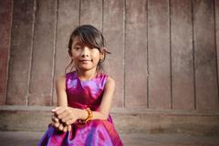 Stock Photo of cute and happy little asian girl smiling at camera