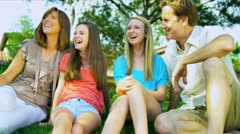 Couple with Teenage Daughters Garden Stock Footage