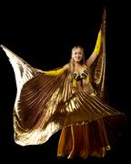 blond woman dance with gold wing - stock photo
