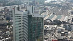 The Deutsche Bank Tower with the Frankfurt Mainstation in the Background Stock Footage