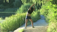 Woman excercising in the park Stock Footage