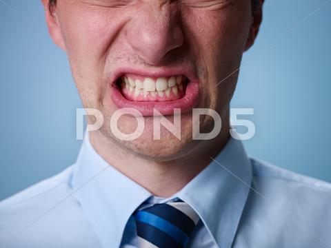Stock photo of angry man shouting at camera. close up
