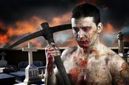 Male zombie in a cemetery, undertaker with pick axe Stock Photos