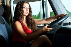 young attractive girl drive big truck - stock photo