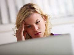 Headache and health problems for young woman at work Stock Photos