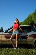 Sexy young woman stay near retro graffiti car Stock Photos