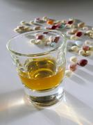 Liquor with pills Stock Photos