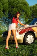 sexy girl washing a car - pin-up style - stock photo