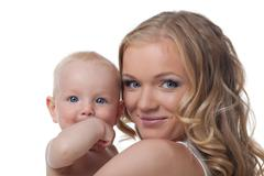 Stock Photo of beauty blond mother with baby look on camera
