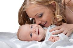 Stock Photo of beauty blond woman kiss a baby