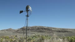 951 spinning desert windmill, old west Stock Footage