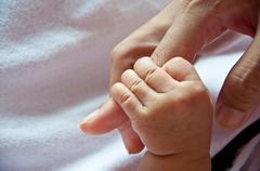 Baby hand Stock Photos