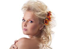 beauty naked woman portrait with flower blond hair - stock photo