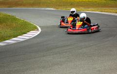 Cars of kart in closed circuit of competition Stock Photos