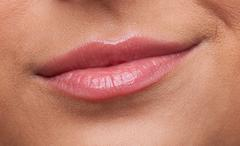 Stock Photo of beauty woman lips smile contempt close-up