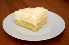 Luscious alice of a tangerine-cream-cake. Stock Photos