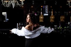 pretty woman stand in bar look on light tonight - stock photo