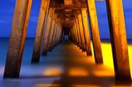 Underside of pier at night Stock Photos
