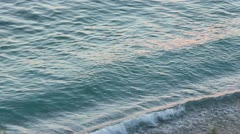 Surf waves, pink sunset and summer coast (Himare, Albania) Stock Footage