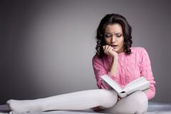 beauty woman in dark read scare book - stock photo