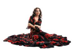 young woman sit in gypsy black and red costume - stock photo