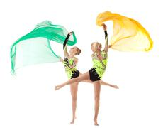 Two beauty acrobats dance with flying cloth Stock Photos