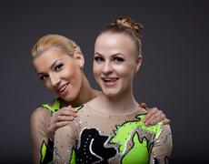 Two beauty acrobats woman friendly portrait Stock Photos