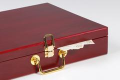 red wooden box with the money - stock photo
