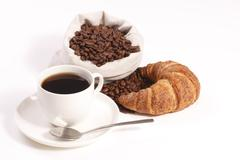 cup of hot coffee with croissants - stock photo