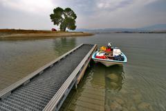 Boat at Lake Dock - stock photo