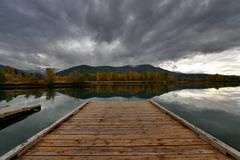 Storm Over Lake and Dock - stock photo