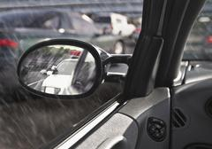 Police car in rearview mirror Stock Photos