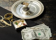 Selling gold for cash Stock Photos