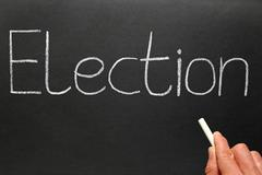 Election, written with white chalk on a blackboard. Stock Photos