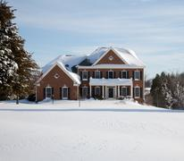 modern single family home in snow - stock photo