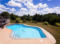Backyard swimming pool and patio Stock Photos