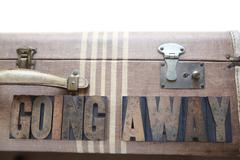 Vintage luggage with words going away.jpg Stock Photos