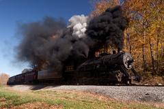 Wm steam train powers along railway Stock Photos