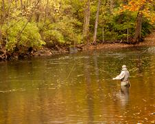 flyfishing angler - stock photo