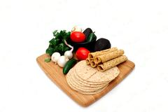 Tortillas, taquitoes and veggies Stock Photos