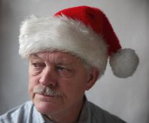 annoyed senior with a Santa hat.jpg - stock photo