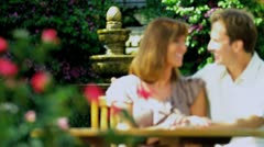 Young Couple Enjoying Garden in Summer Stock Footage