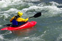 kayak in the whitewater - stock photo