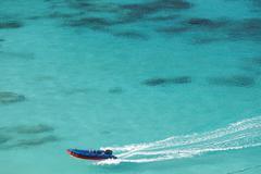 speedboat on tropical sea - stock photo