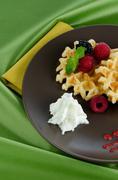 Stock Photo of tasty waffle with fruits