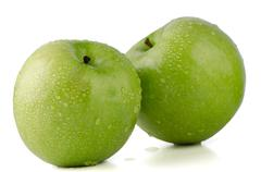 Two fresh green apples Stock Photos