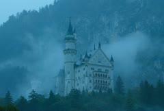 Time lapse movie of mist floating across neuschwanstein castle in germany Stock Footage